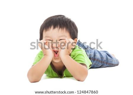 little boy makes a funny face