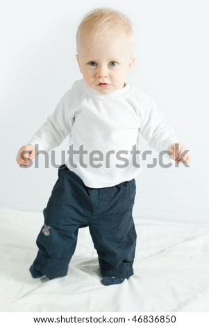 little boy making his first steps - on white