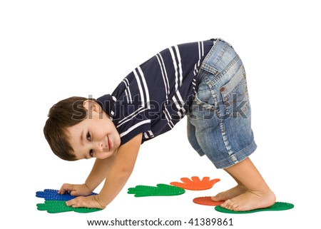 little boy massages feet and hands