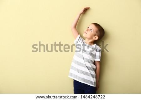 Little boy measuring height near wall #1464246722