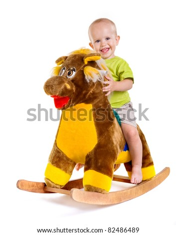 little boy on a toy horse.child on a white background.game