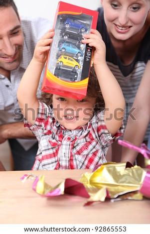 Little boy opening birthday present