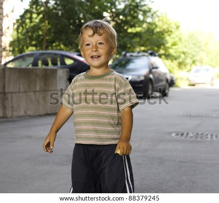 little boy outside - stock photo