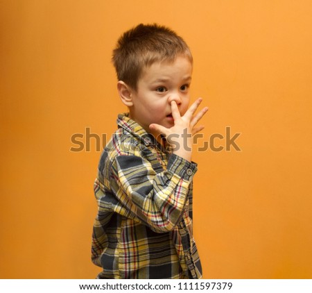 Little boy picking his nose. Funny picture of boy. Bad habit