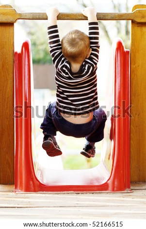 little boy playing at the playground - stock photo