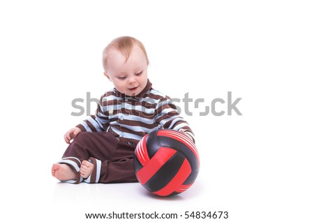 little boy playing ball