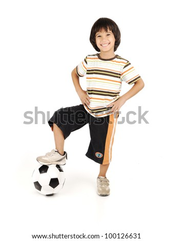Little boy playing football isolated on white background