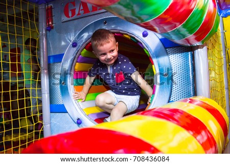 little boy playing in the maze #708436084