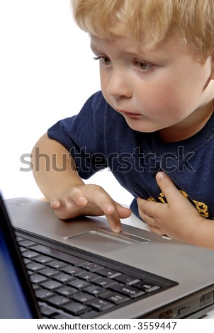 little boy playing on Laptop on white background