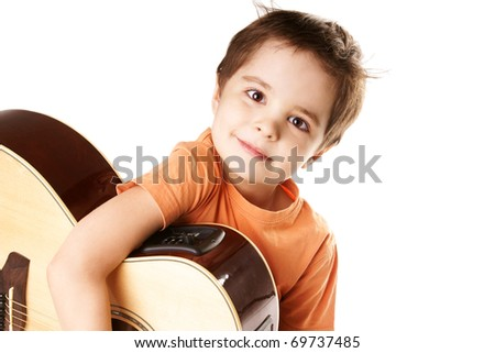 Little boy playing the guitar isolated on a over white background