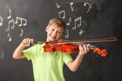 Little boy playing violin at music school