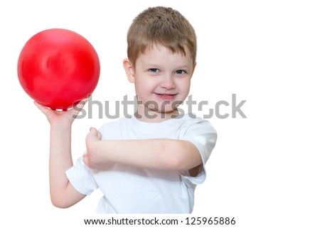 Little boy playing with a ball, horizontal photo.