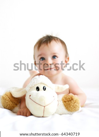 Stock Photo Little boy playing with a lamb
