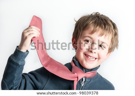 Little Boy playing with a tie - studio shot