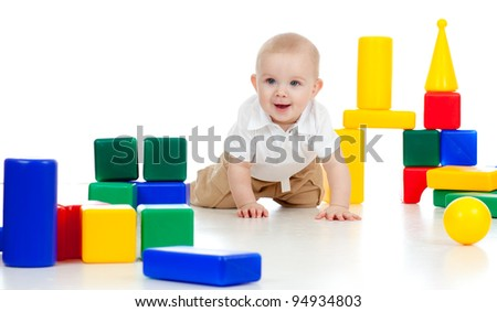 little boy playing with building blocks