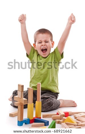little boy playing with colorful blocks, isolated on white background