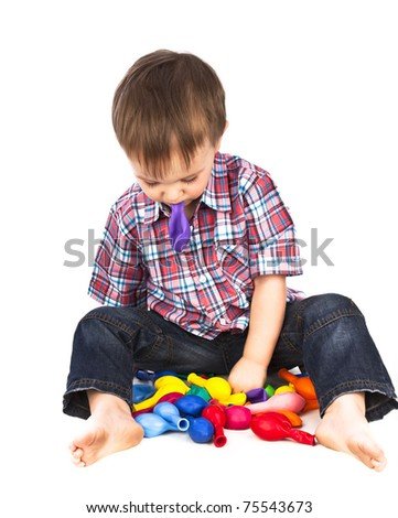 Little boy playing with inflatable balls colored white background isolated