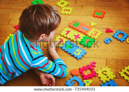 little boy playing with puzzle, education concept #735904033
