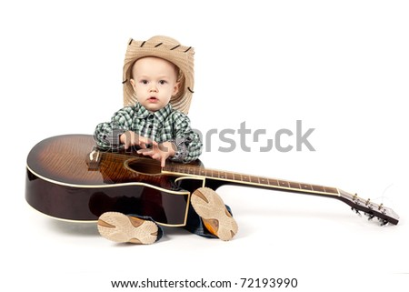 little boy plays guitar isolated on white
