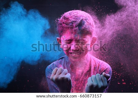 Little boy plays with colors.Concept for Indian festival Holi. #660873157