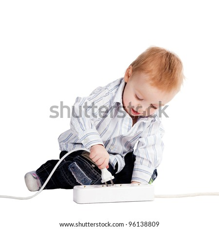 little boy plays with plug