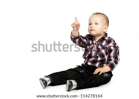 little boy poins up