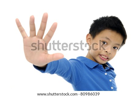 little boy portrait saluting isolated studio - stock photo