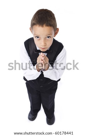 little boy praying isolated on white
