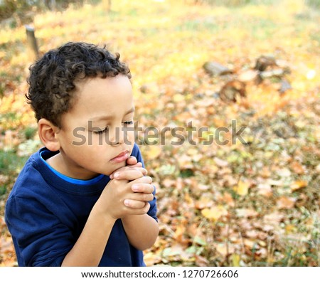 little boy praying to god with hands together stock image stock photo #1270726606