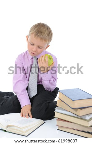 Little boy reading a book. Isolated on white