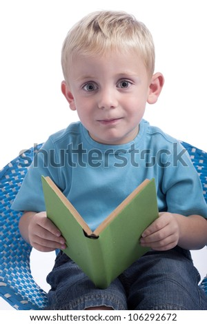 little boy reading a book. Isolated on white background