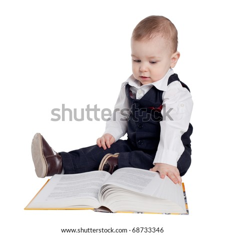 little boy reads a book