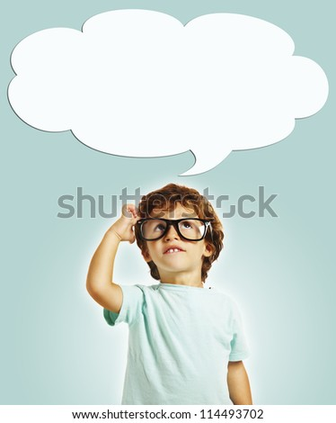 little boy scratching his head thinking with copy space