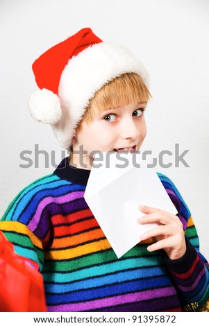 Little boy sending a letter to Santa Claus