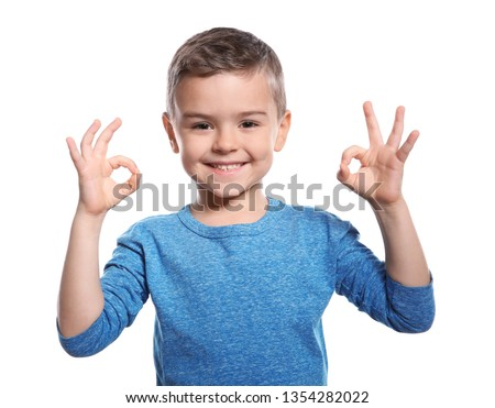 Little boy showing OK gesture in sign language on white background Stock photo ©