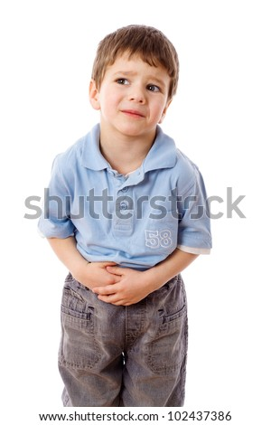 Little boy showing stomach pain, isolated on white