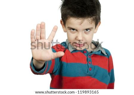 Little boy showing stop with his hand. White isolated