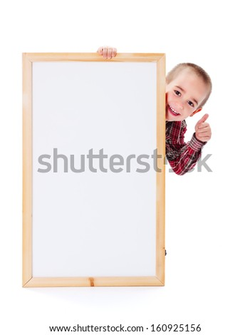 Little boy showing thumbs up behind blank billboard