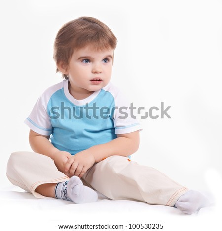 little boy sits on floor