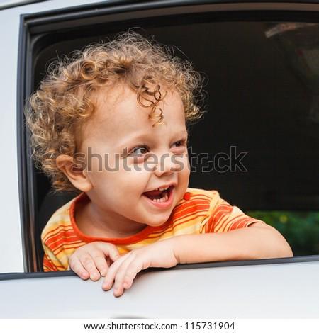 little boy sitting in the car