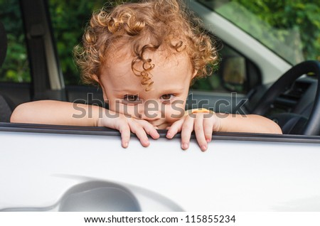 little boy sitting in the car