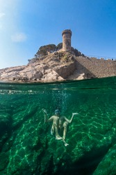 Little boy snorkeling with a castle in the background