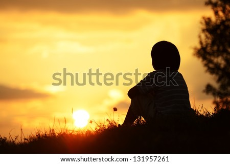 Little boy spending happy time on summer nature