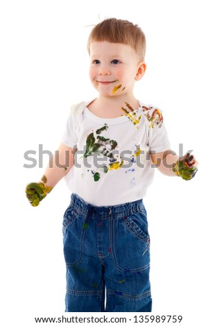 little boy stained in paint, isolated on white