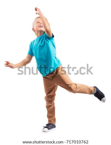 LITTLE BOY STANDING ON ONE LEG ISOLATED ON WHITE BACKGROUND