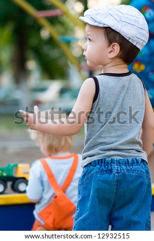 Little boy stay on playground