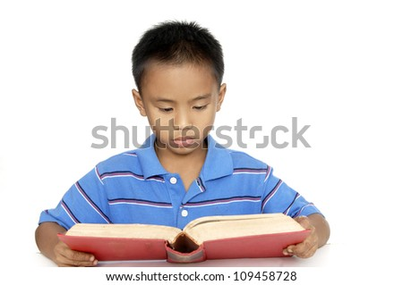 Little boy studying a over white background