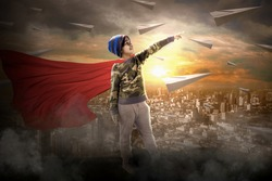 Little boy super kids and super heros, standing on cliff of mountain,background lot of paper airplane in sky,and cityscape full cloud and fog,paper plane concept and children dream and imagination