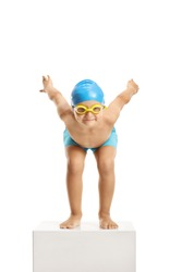 Little boy swimmer with a cap and googles preparing to jump and swim isolated on white background