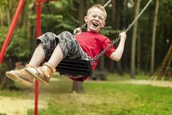 Little boy swinging